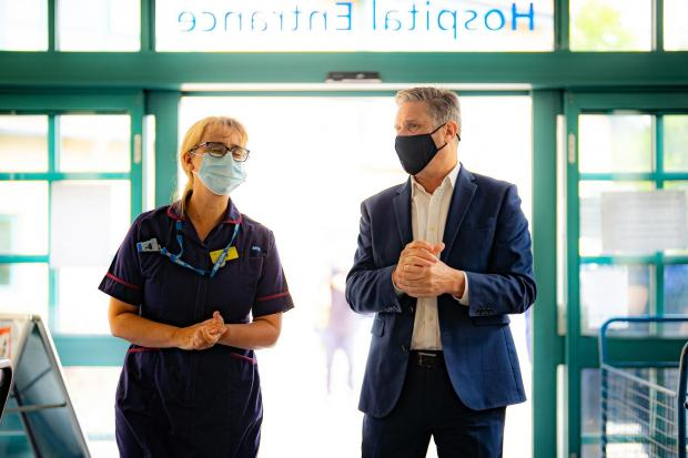 Stroud News and Journal: Labour Party leader Sir Keir Starmer with Matron Liz Lovett as they enter Stroud General Hospital in Gloucestershire
